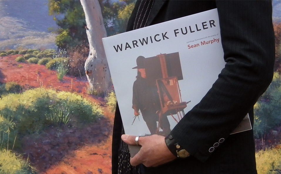Image of man holding Warwick Fuller's book